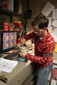 Chris Jensen prepping a can of paint