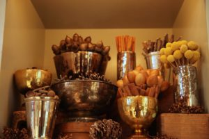 A cubby filled with acorns, cinnamon sticks, twigs, pine cones, and more