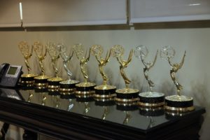Our lineup of Emmys on display in the large green room