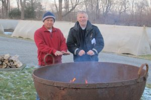 Gyurme and Dominic - grounds crew - warmed their hands at the fire pit, which was moved to this location for the party.
