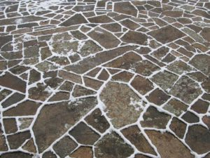 A snow-edged jigsaw puzzle out on the terrace.