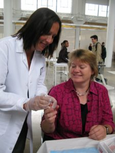 Mary drawing blood for Linda's screening
