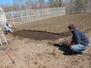 Wilmer and Ryan, the new gardener, are reconfiguring the vegetable beds.