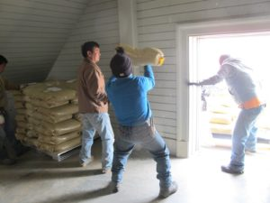 A shipment of horse bedding was delivered and the grounds crew loaded it into the stable loft.