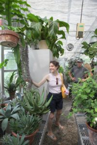 Inbal was intrigued with a hanging succulent in the greenhouse.