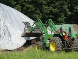Alfredo used the John Deere to get a load of top soil.