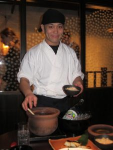 The chef serving rice pot