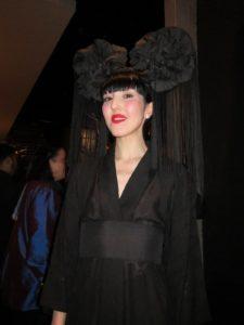 Michelle Harper wearing a Pierce Atkinson headdress.