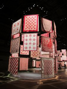 Defying gravity, the quilts appear to spiral in mid-air, creating circular pavilions.