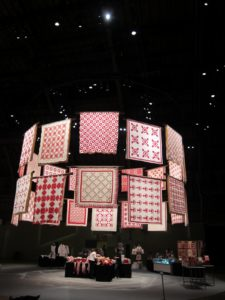Those circular forms invite visitors to experience the quilts in a three-dimensional environment.
