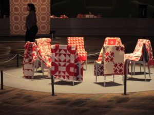 Most of these quilts were created by women sitting in circles, like this one, called quilting bees.