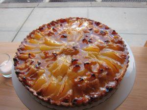 Glazed peach and berry tart