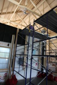 Scaffolding behind the 'false' wall for behind-the-scenes action