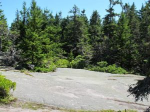 Baker Island is known for its flat rock formations.  On the south shore is a series of huge flat slabs of granite, referred to as the 'Dance Floor,' where dances were actually held.