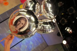 Similarly, you can attach photos to Mylar balloons using spray adhesive.