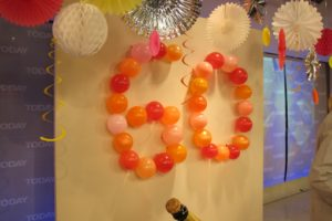 Create a grand gesture with balloons.  Attach blown up balloons to a wall with double-sided tape.