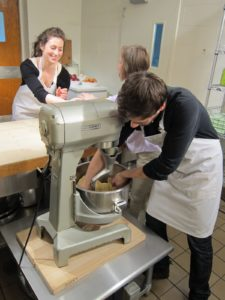The kitchen staff mixing the yeast dough for Ukrainian paska