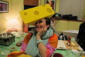 Charlie Green, my makeup artist, clowning around with the Green Bay Packers cheesehead