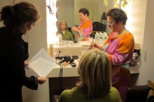 Judy briefed me while Charlie touched up my makeup.