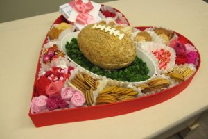 This is the gift that I prepared for Dave - a cheese football, crackers, candy, and more.  For instructions on how to make this heart-shaped box - http://thecraftsdept.marthastewart.com/