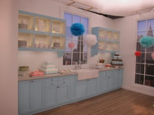 The kitchen set with cakes and cookies decorated using the Cricut Cake machine.  The pom-poms were made using our Pom-Pom Party Packs.