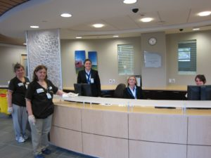 A meticulous cleaning staff keeps the place clean and tidy.  Behind the desk are two concierges and an ER nurse.
