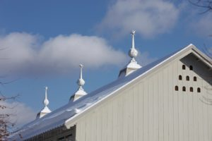 The finials atop the equipment barn are Swedish or French lead-coated copper.