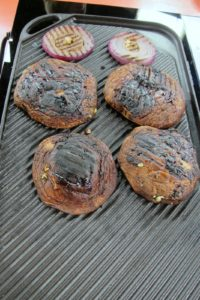 As the portobello mushrooms grill, their moisture evaporates and they become quite 'meaty' in texture.