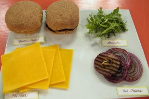 Build the burger with cheddar slices, grilled red onions, and arugula.  Of course, choose whole wheat buns and grill them, too!