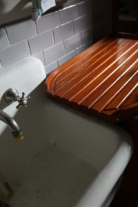 Each sink has its own wooden drainage board.