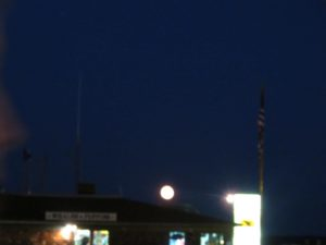 The great big full moon rose over the restaurant.