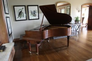 My beautifully restored Steinway player piano looks stately in one corner of the parlor.