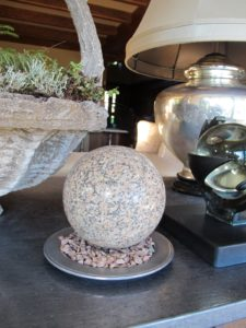 The smooth, round, pink granite spheres were made for me by Fresh Water Stone.