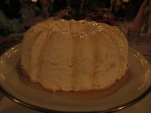 The unmolded Ile Flottante drizzled with caramel.