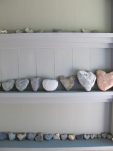 This is my collection of heart-shaped rocks, which I find along the beaches in Maine.  What can I say?  I just love it!