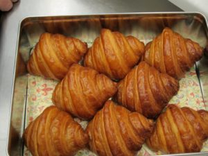 A tin of freshly baked croissants