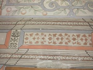 Hand painted - the decoration pre-dates wall paper.