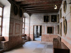 Another room with many portraits
