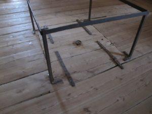 The vault for gunpowder lies beneath the wooden floor.