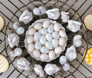 From above, this white collection of glass and porcelain bunnies and eggs looks so charming.