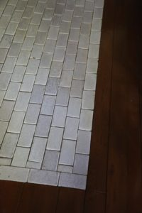 The original subway tile makes for an excellent back splash and floor surround for the stove area.