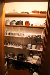 Conveniently located to the right of the cooking area is the cookware pantry.