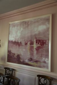The large-scale painting in the dining area is of a Venetian lagoon, and was painted by my late friend Kevin Burger.