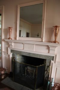 The mirror frame above the fireplace, for example, was painted the same pink as the cottage's walls and trims.