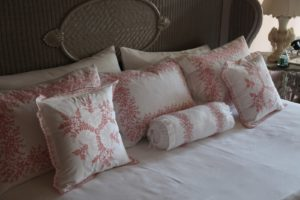 The bed is accentuated with beautiful French sheets and hand-embroidered pillowcases.