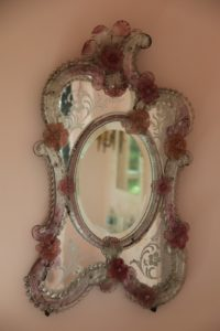 Above the towels hangs an ornate pink Venetian mirror, which I found several years ago at a consignment store.