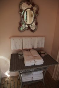 Pink is also worked into the decor of the bathroom with these charming embroidered bath towels.