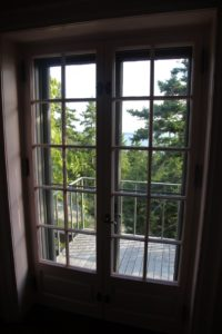 The balcony off the bedroom - As you can see, the cottage is perched on a bluff overlooking the harbor below.