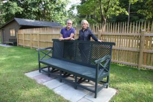 This garden bench, the Almodington Bench, made John famous.  It has a prominent place in his garden.  The fence behind us is a reproduction of a fence John saw in Sweden.