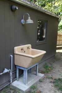 An old laundry sink serves as an outdoor wash basin - John found this on one of his hunts in New York state.